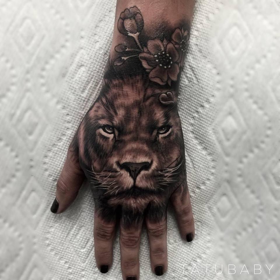 Lion With Flowers Tattoo On Hand Blurmark