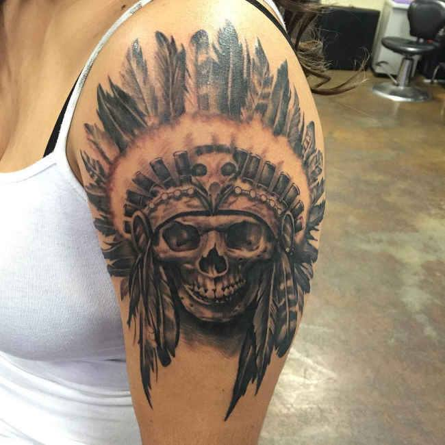 Skull With Feather On The Shoulder
