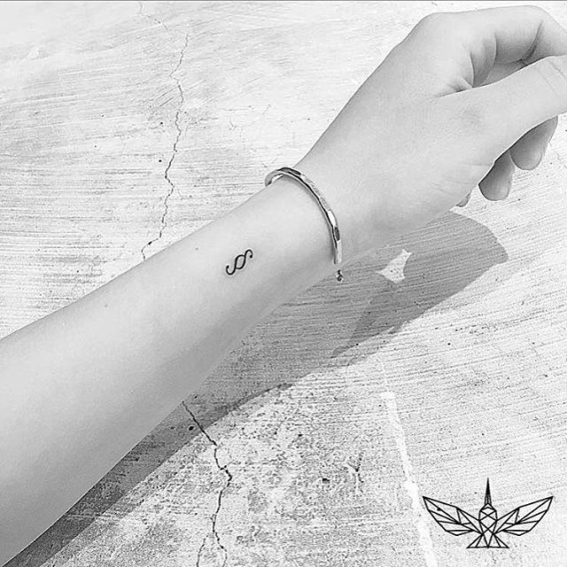 Black Tattoo On Wrist