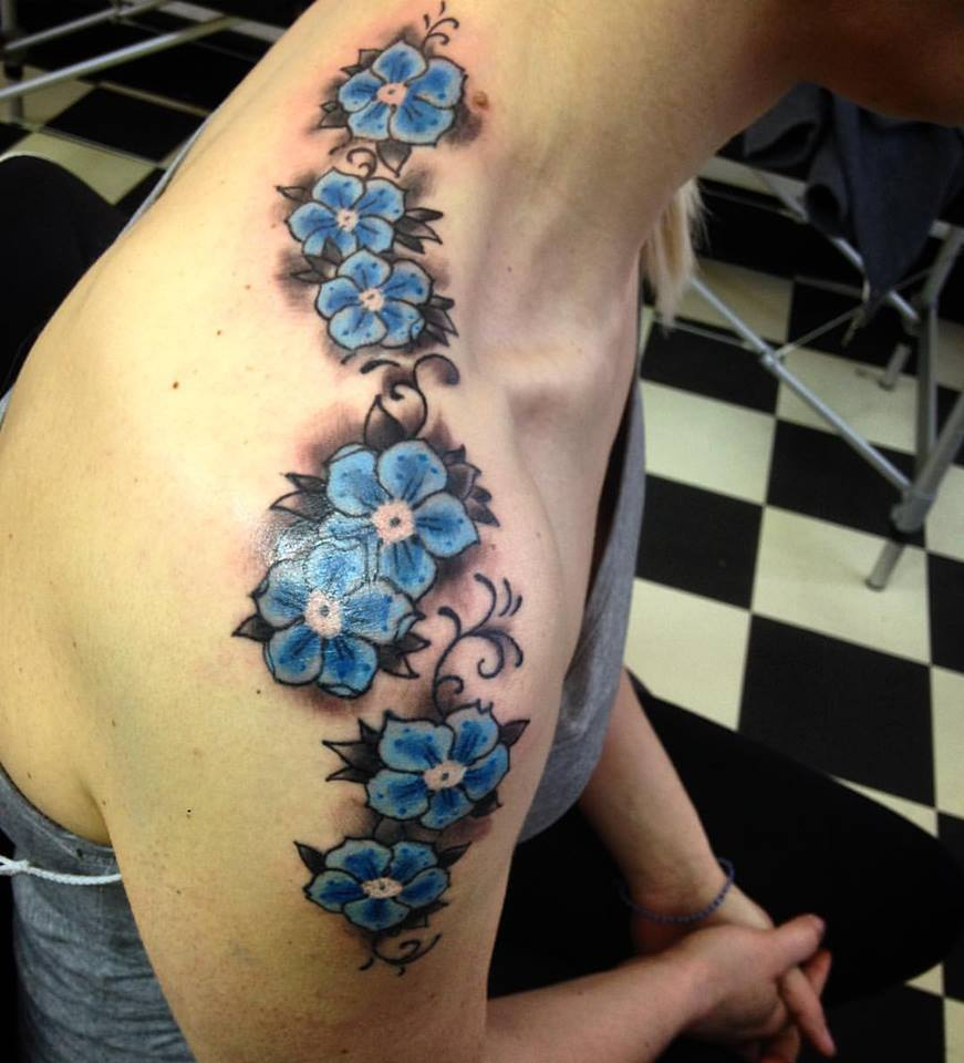 52 incredible flower tattoo designs for women blue flowers on shoulder blue rose tattoo izmirmasajfo Choice Image