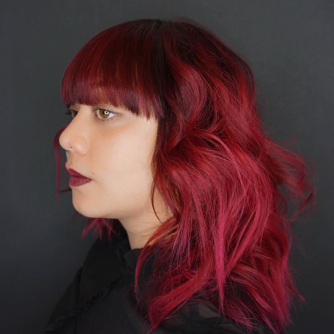 Fringe Haircut With Bright Red Color
