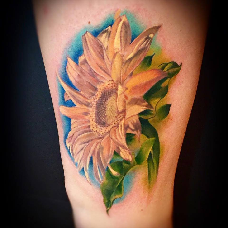 52 incredible flower tattoo designs for women for Sunflower tattoo thigh