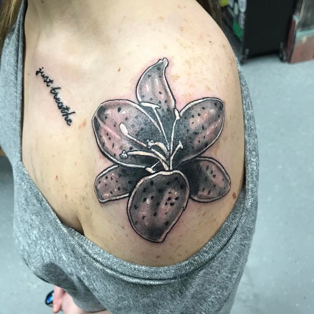 60 amazing lily flower tattoo designs for girls beautiful lily flower tattoo on shoulder izmirmasajfo Choice Image
