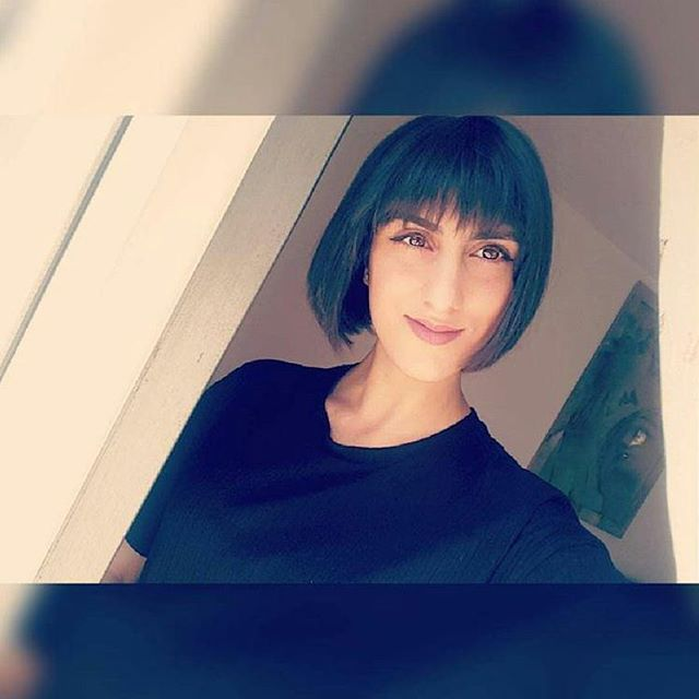 Black Short Haircut With Bangs