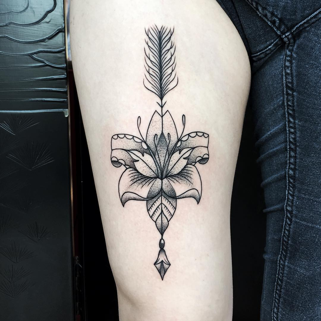 60 amazing lily flower tattoo designs for girls dot work lily flower arrow tattoo on thigh izmirmasajfo
