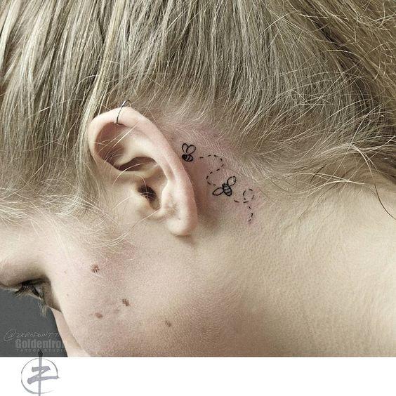 Flying Bee Behind The Ear Tattoo