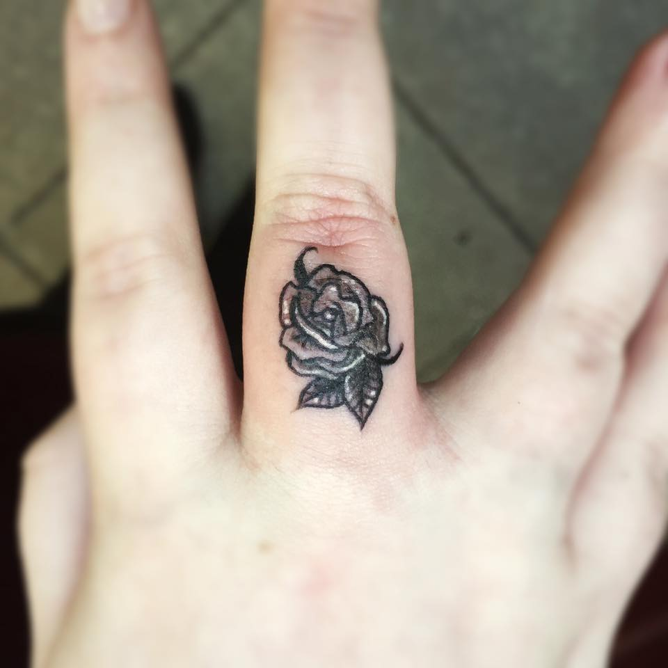 Finger tattoo cons 67 different finger tattoo ideas that for Wedding ring tattoos cost
