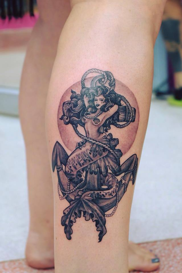 Mermaid & Anchor Tattoo On Lower Leg