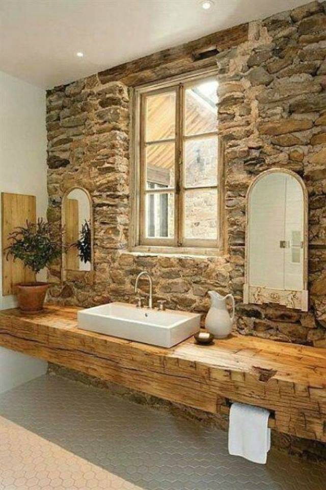 Natural Stone Wall With Wooden Furniture And Mirror
