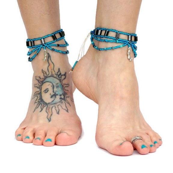 Sun With Moon On Foot