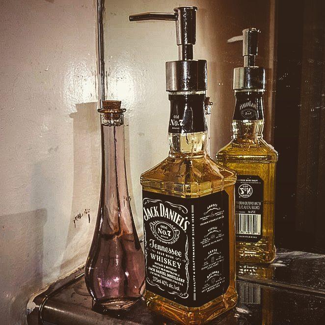 Empty Whiskey Bottle Used As Hand Wash