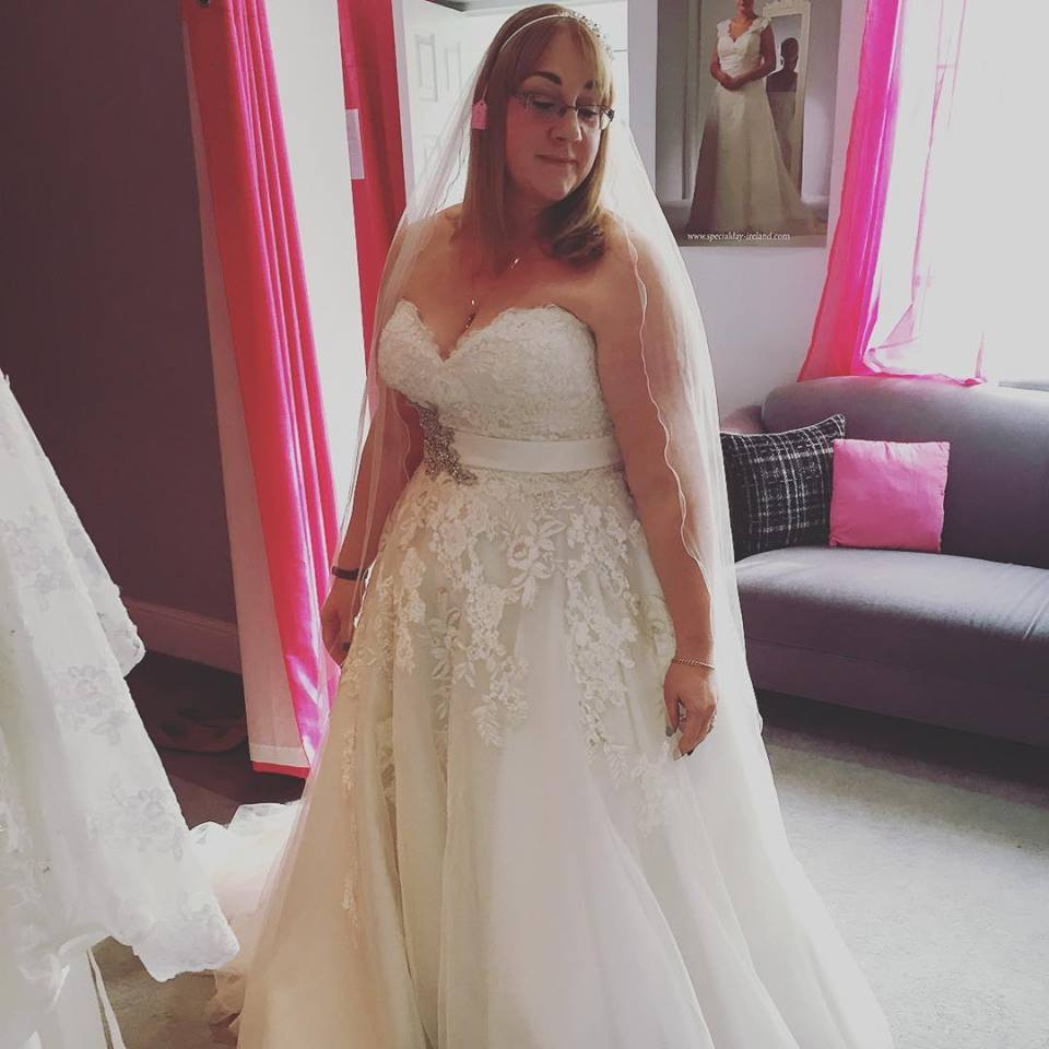 Strapless Plus Size Wedding Dress Has Embrodried Lace And Satin Belt On Waist