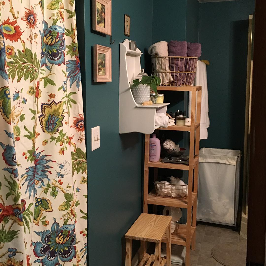Wooden Stool Used As Storage And Decor With Floral Curtain