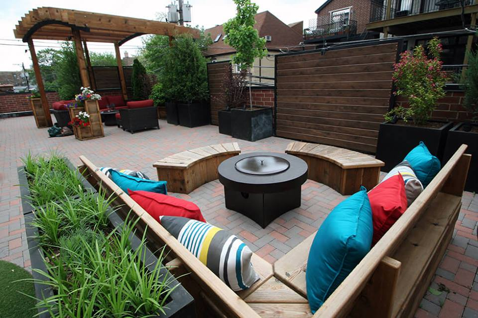 Alluring Rooftop Garden With Colored Pillows U0026 Round Wooden Sitting Space