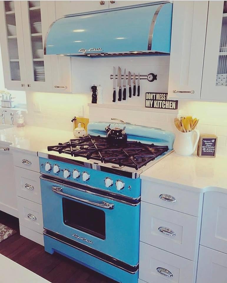 Beach Blue Stove & White Cabinets