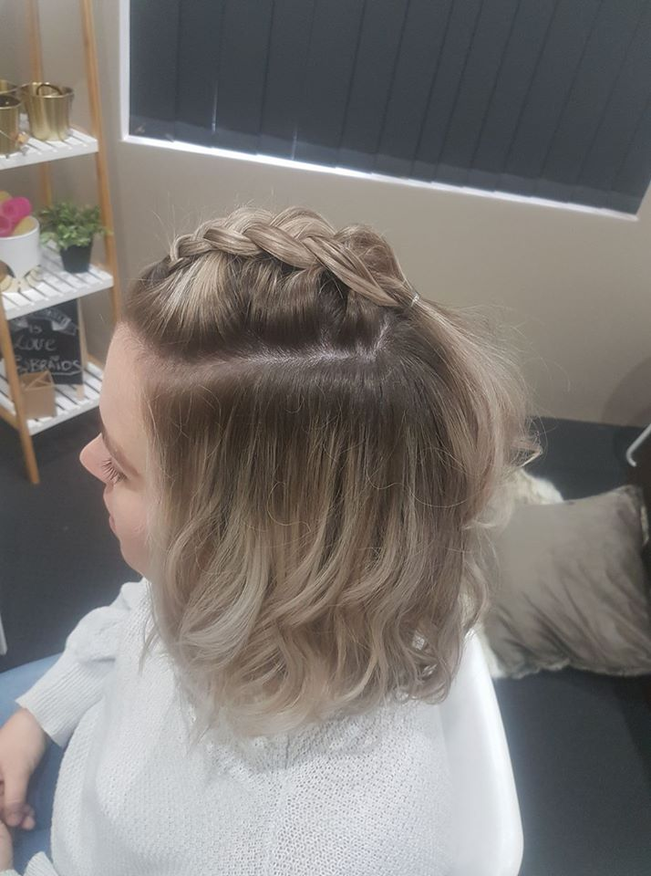 Beautiful Blonde With Beach Waves And Loose Dutch Braid