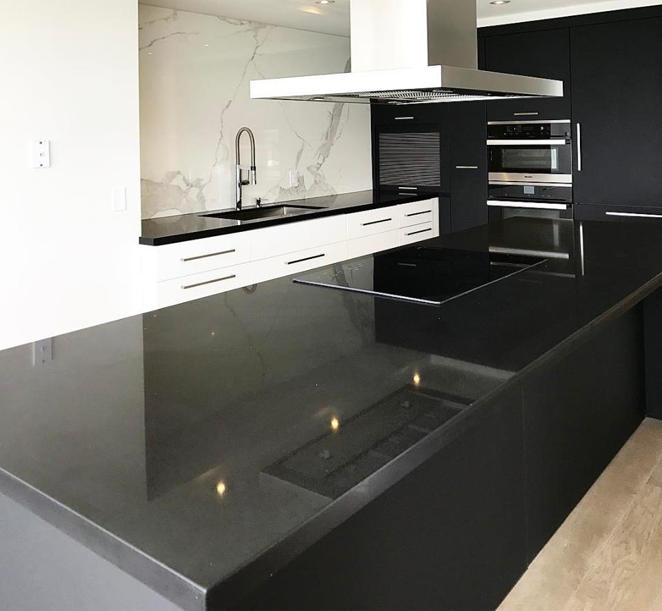 Black Contemporary Condo Kitchen With Porcelain Backsplash