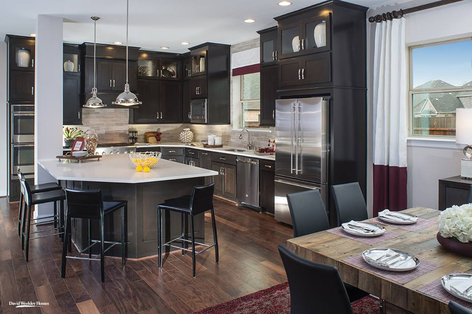 Dark Cabinets, Hardwood Floors With Light Countertop & Backsplash