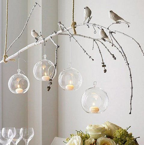 Decorate Tree Branches Inside By Sitting Artificial Birds On It And Hanging Candles