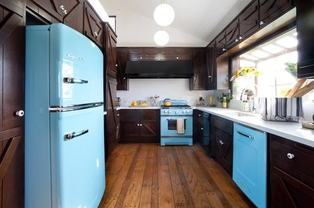 Eye Catching Kitchen With Blue Fridge, Stove And Brown Cabinets