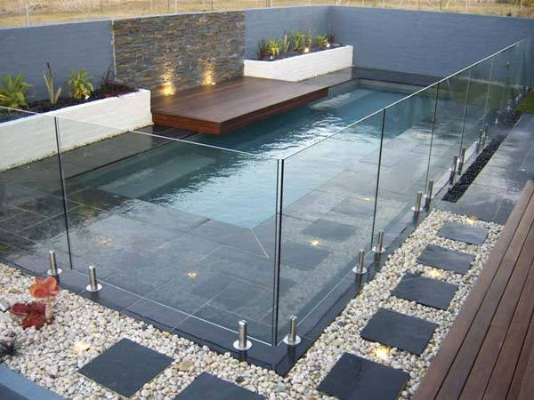 Fantastic Pool Design With Glass Boundry