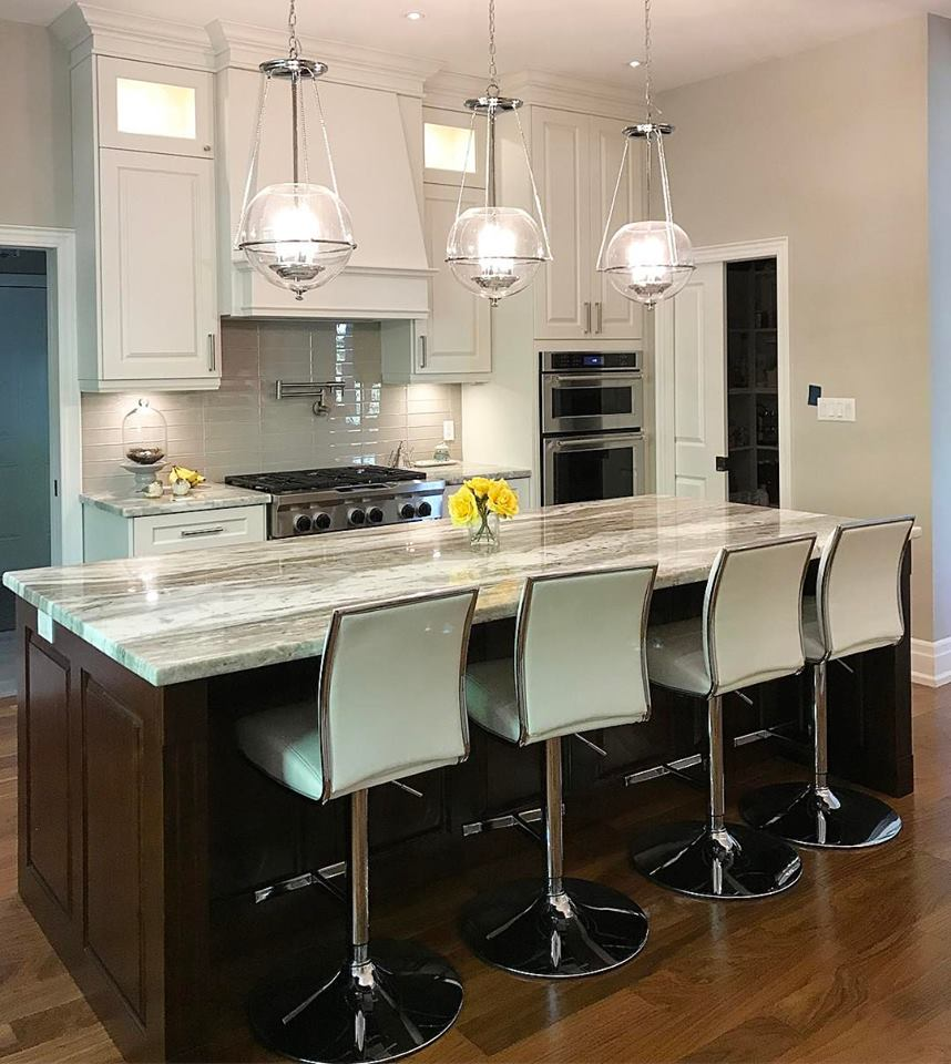 Gorgeous Brown Quartzite Countertop With Stylish Chairs And Modern Light Fixers
