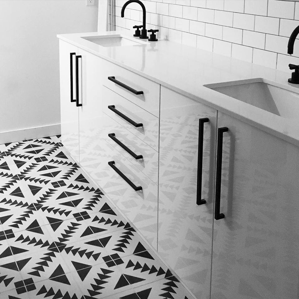 Impressive White Sink & Cabinet With Tribal Patterened Floor Tile Adds Texture