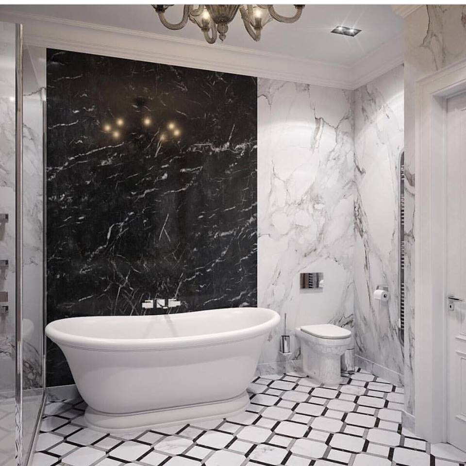 Lavish Black & White Marble On Wall With White Bathtub & Vanity
