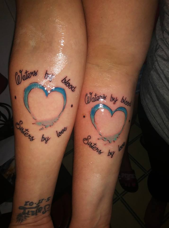 Matching Heart Sister's Tattoo On Arm