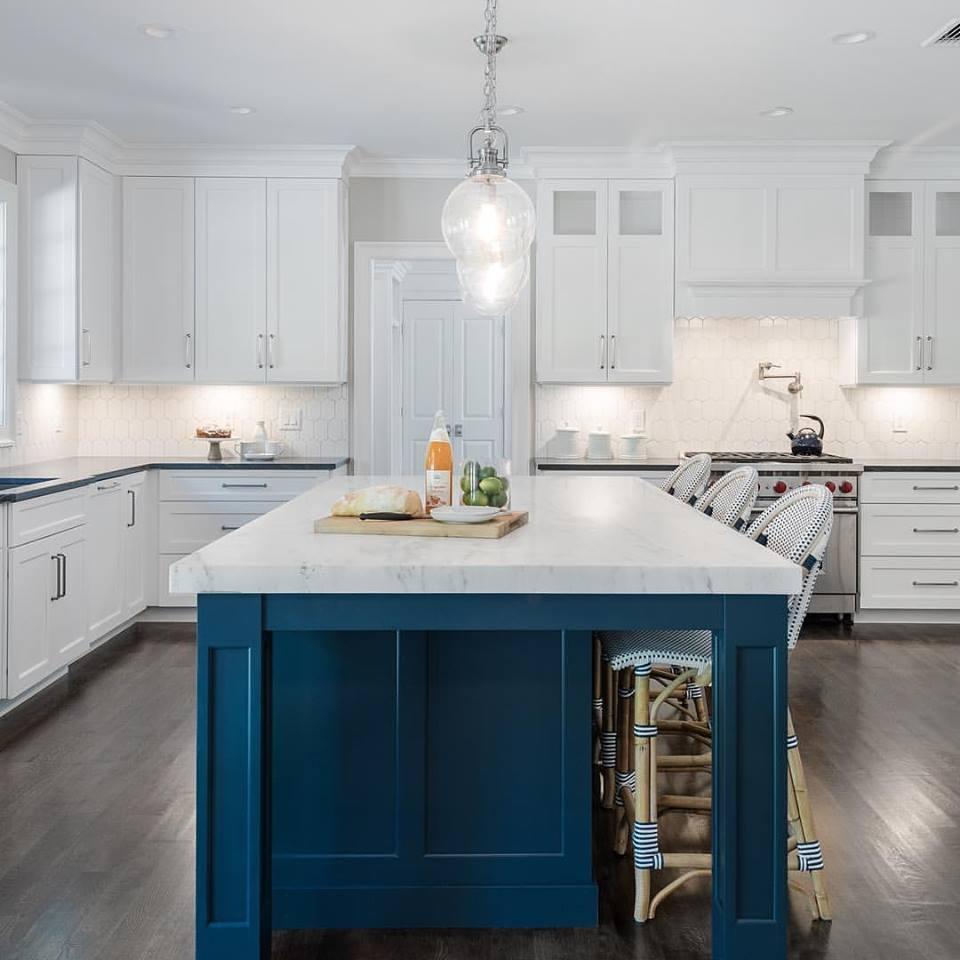 Navy blue kitchen island with white kitchen design