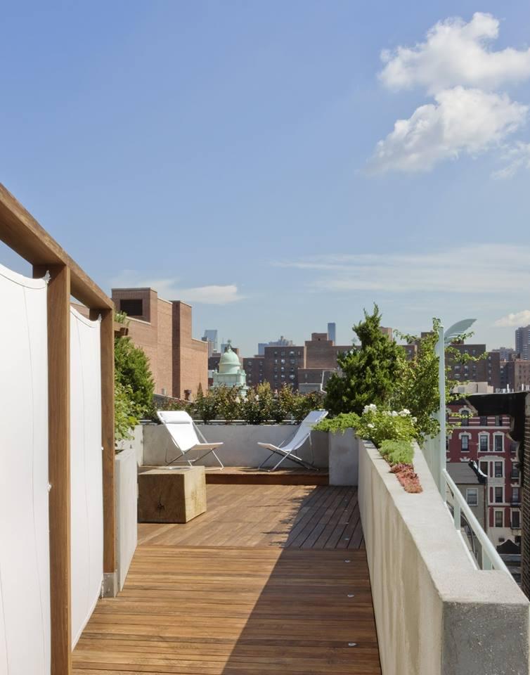 Pretty Rooftop Garden Idea With White Furniture