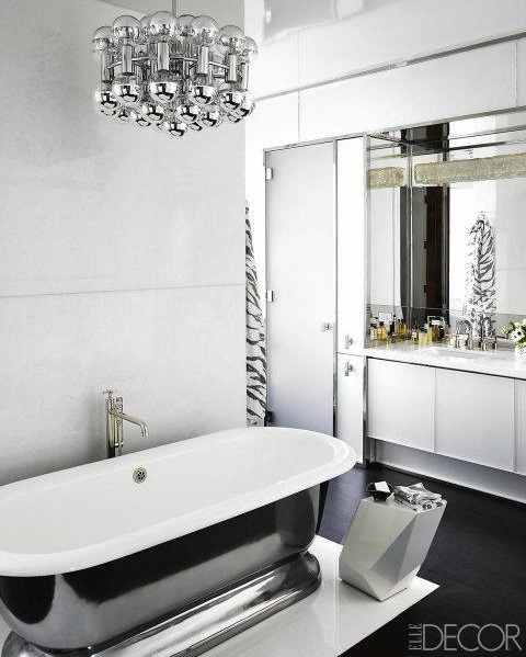Ravishing Black Flooring, Black & White Bathtub, White Cabinets & Chandelier