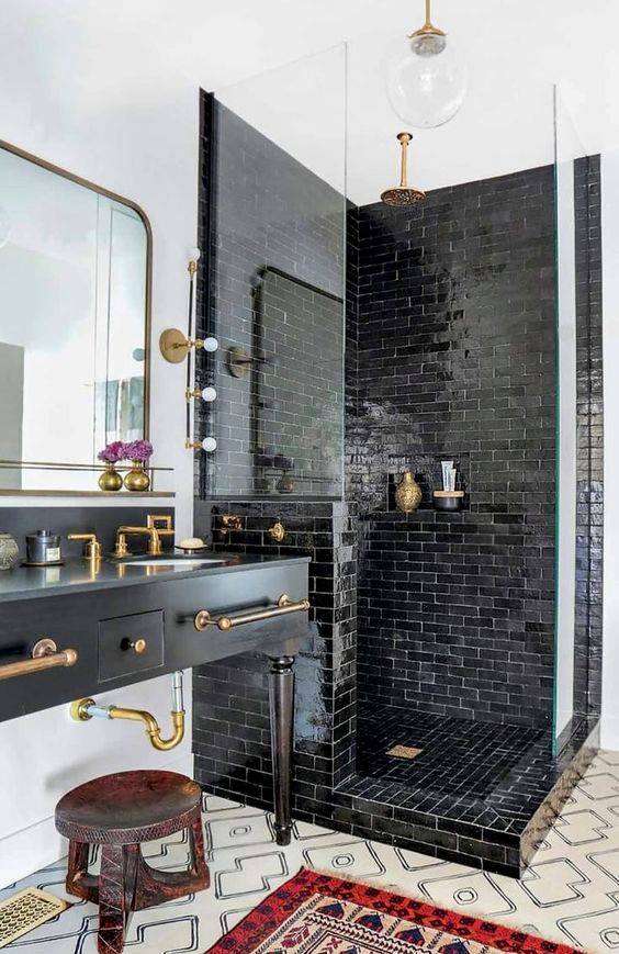 Stylish Black And White Bathroom Combination With Golden Decor And Bulb Lighting