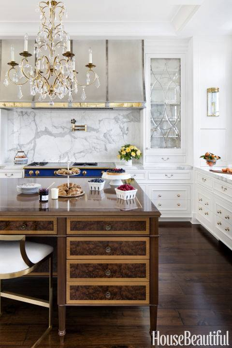 Stylish Countertop With Gorgeous Chandelier & White Cabinets