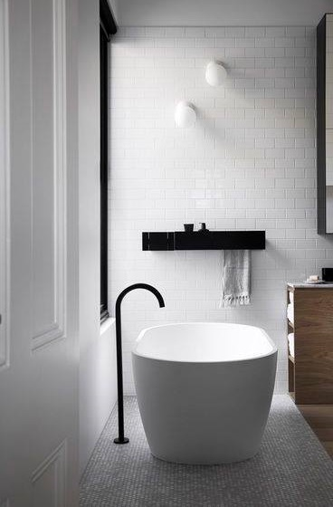 Swanky Black & White Bathroom Design With Subway Tiles From Floor To Ceiling, Touches Of Black And A Mix With Wood