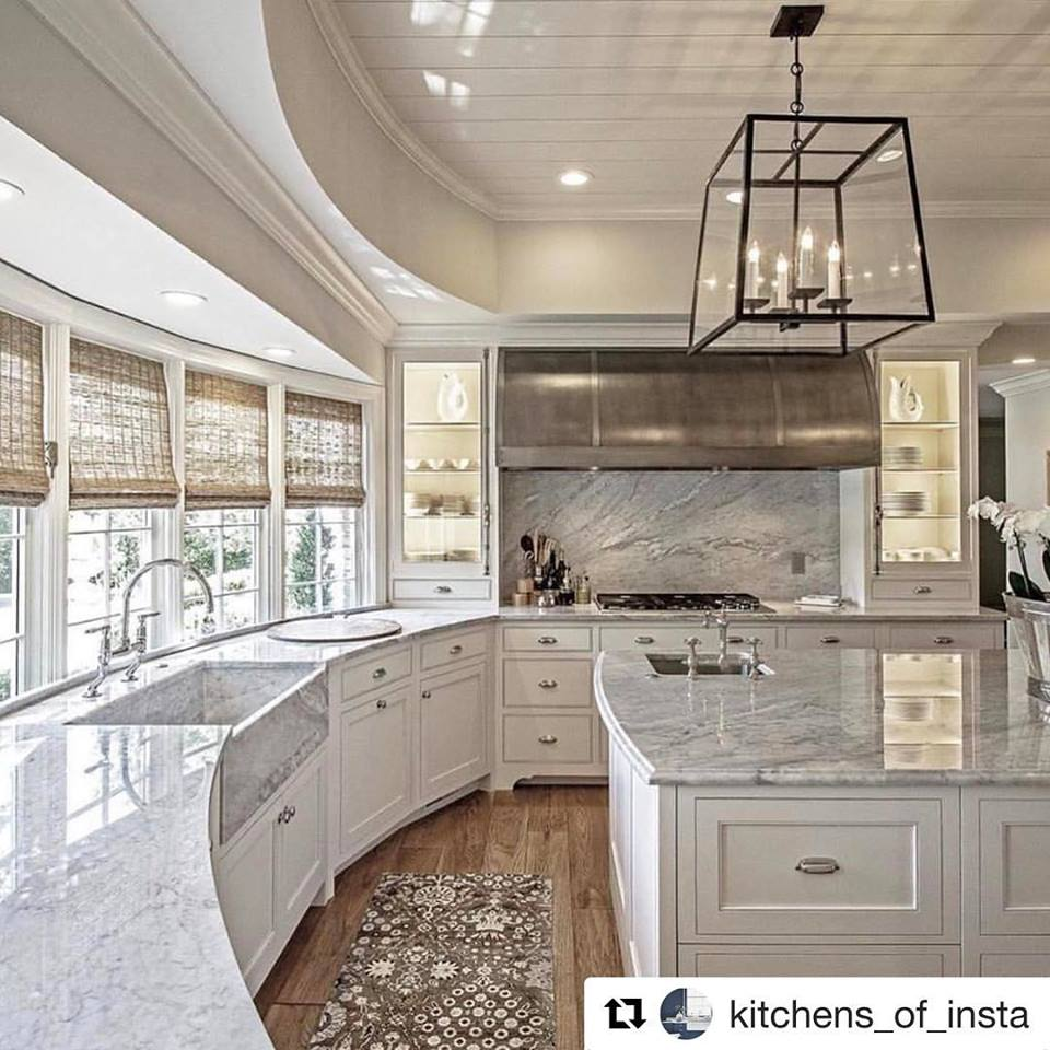 Wonderful Curved Marble Kitchen Counter With Beautiful Chandelier