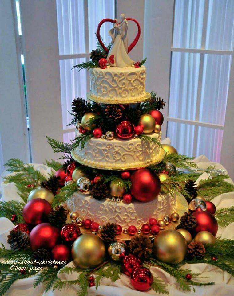 Colorful Pine-Cones And Ornaments On Christmas Cake
