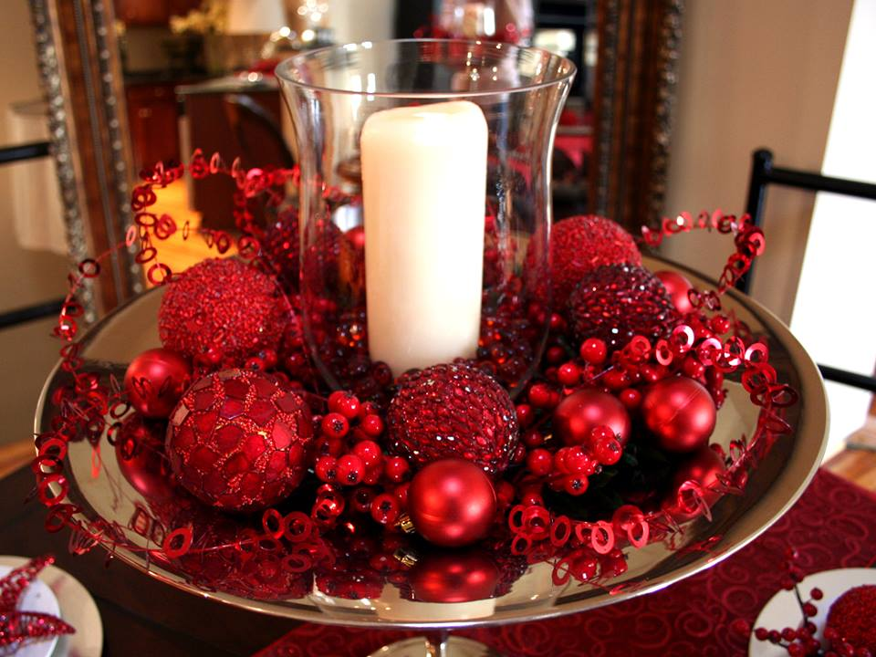 Candle In Glass Vase And Red Ornaments