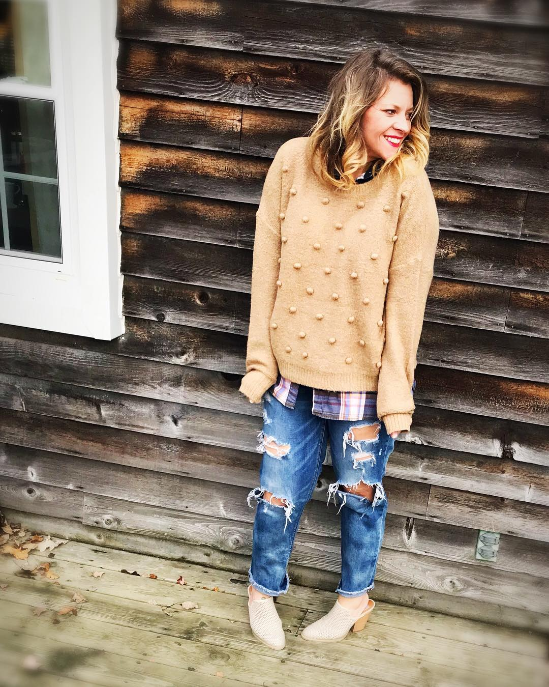 Chic Pompom Sweater Paired With Plaid Shirt And Ripped Jeans