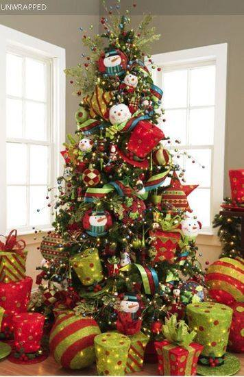 Christmas Tree Is Decorated With Gifts, Small Ornaments And Toys