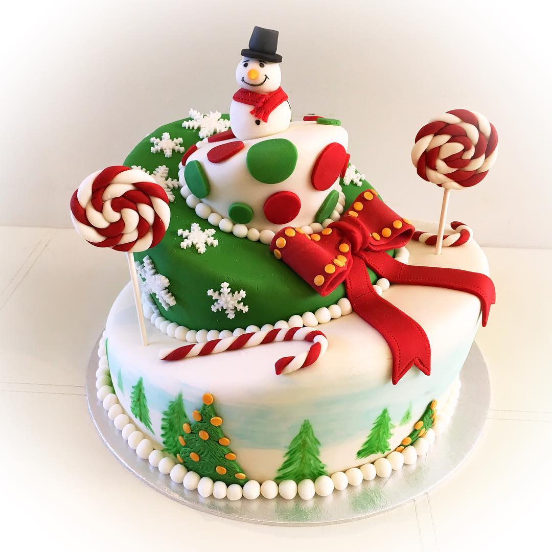 Dashing Colorful Cake With Snowman On Top And Candy