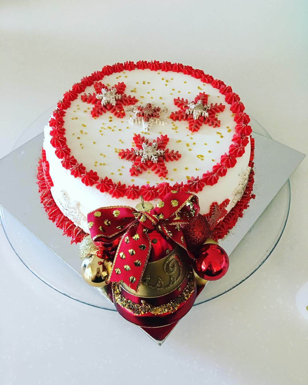 Fruit Cake Is Decorated With Red Cream Like Snoflakes