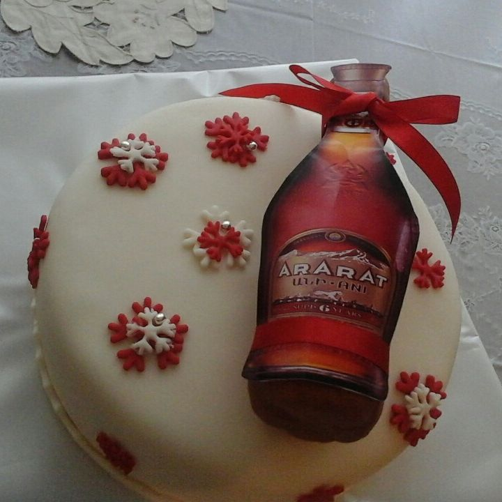Graceful Cake For New Year With Snowflakes And Bottle