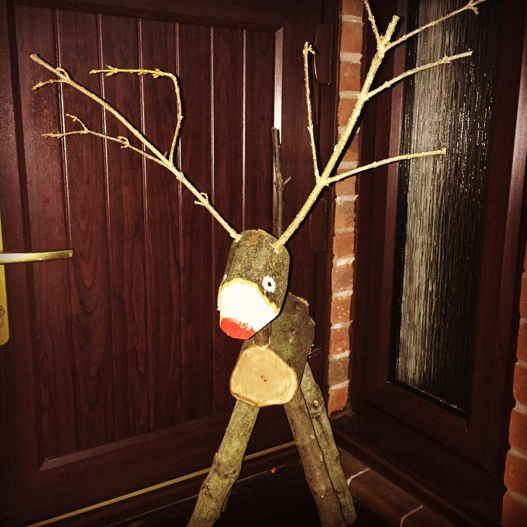 Long Reindeer By Wood