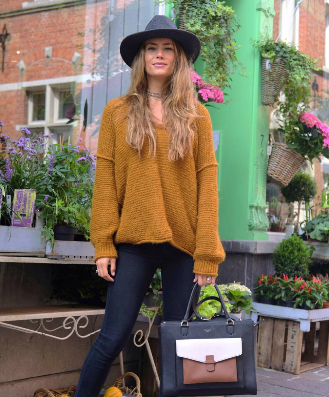 Lovely Mustard Loose Sweater, Jeans, Hat And Beautiful Handbag