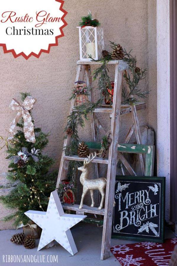 Old Ladder Is Used To Decorate On Thic Christmas With Stars, Pine-Cones And Lantern