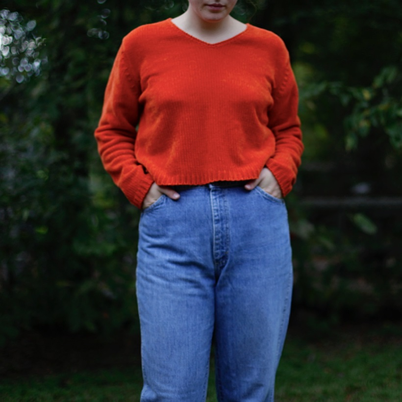Red V-Neck Short Sweater Paired With High Waist Jeans
