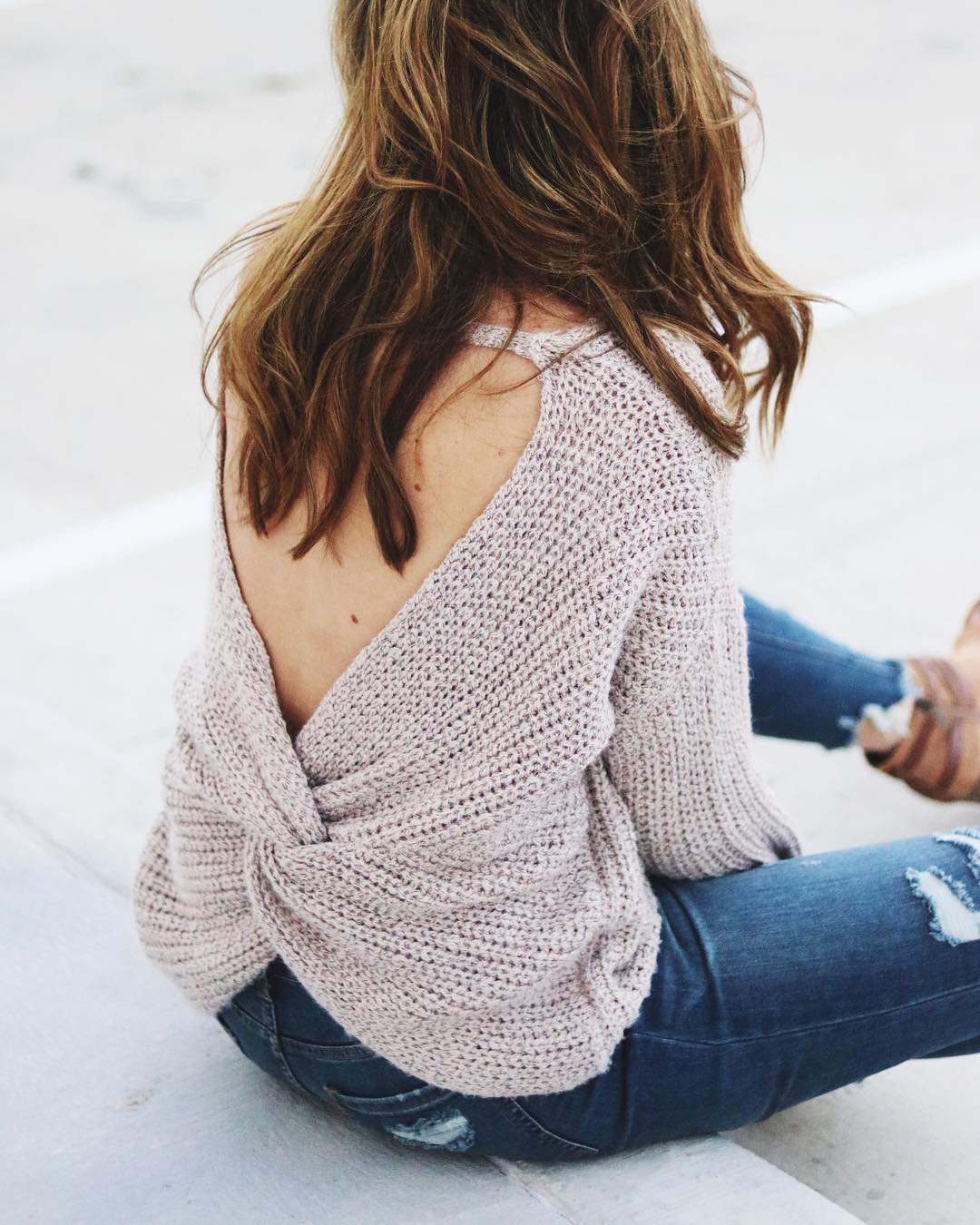 Rocking Backless Sweater With Blue Jeans