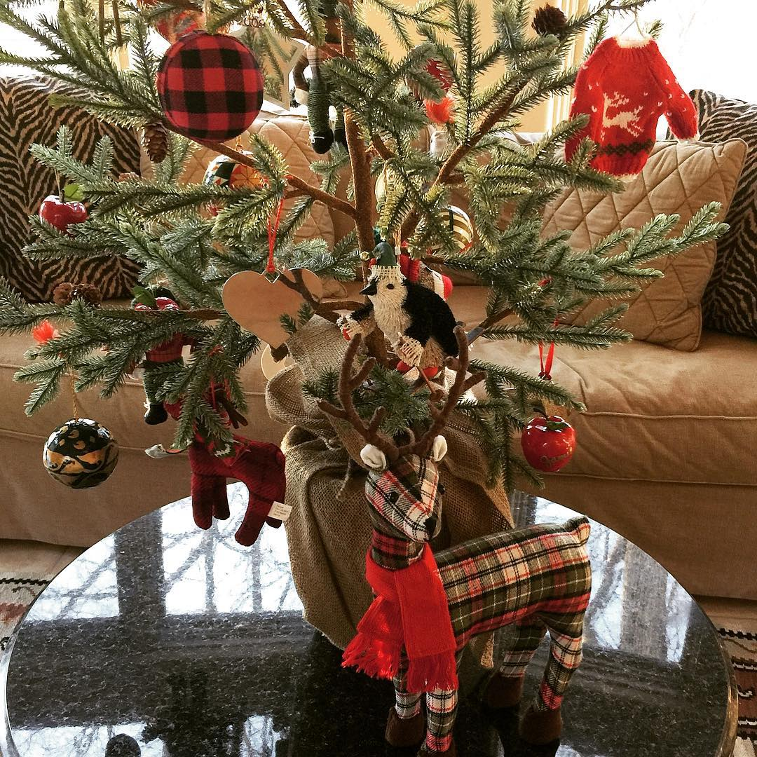Tree Is Decorated With Reindeer And Ornaments