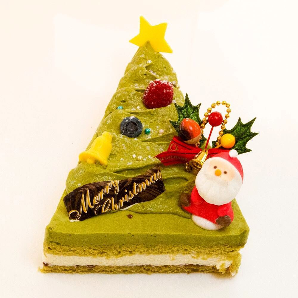 Triangle Cake Decorated With Santa